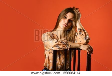 Just Relaxing. Woman Beautiful Face. Female Fashion. Girl Long Hair Sit On Chair. Relaxation Concept
