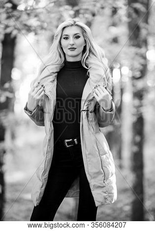 Girl Fashionable Blonde Walk In Park. Best Puffer Coats To Buy. How To Rock Puffer Jacket Like Star.