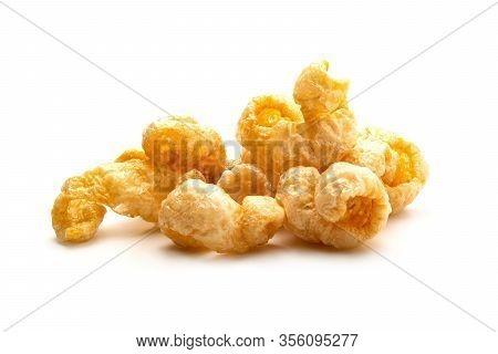Pork Snack Crispy And Blistered Isolated On White Background. Crispy Pork Skin Pieces. Food Concept.