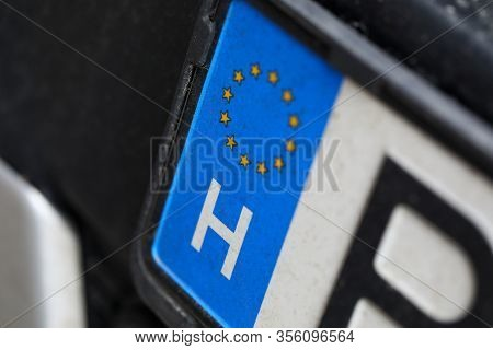 Close-up Of Car European License Plate. Automobile From Eu. Macro Shot Of Registration Number From E