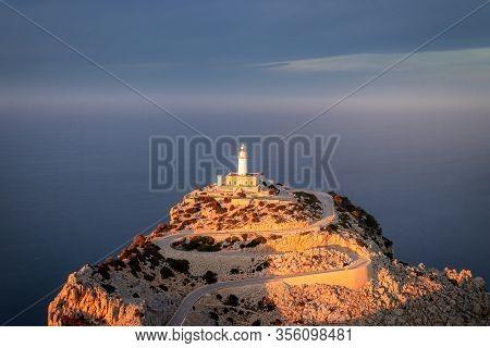 Cap De Formentor Lighthouse With Golden Light At Sunset, Near Pollenca And Alcudia, Mallorca, Spain.