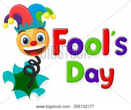 Smiley Face In A Jesters Hat Jumped Out Of A Hole On A White Background, A Place For Text. Fools Day