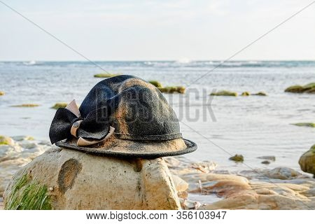The Lost And Forgotten Woman Retro Hat Left On A Stone At The Beach