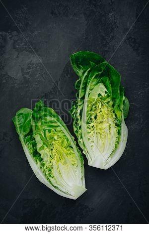 Fresh Green Romaine Lettuce For Caesar Salad On Dark Stone Background.