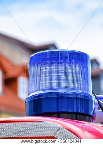 Detailed View Of A Blue Rotating Beacon On The Roof Of A Red Fire Truck