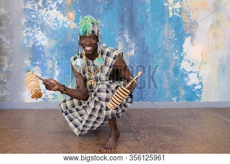 African Musician With Traditional Clothes And Musical Instruments