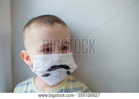 Unhappy Boy In Medicine Mask, Closeup Portrait, Quarantine At Home, Virus Protection