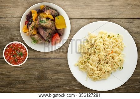 Vermicelli On A White Plate On Wooden Background. Vermicelli On A Plate With Vegetarion Salad Top Vi