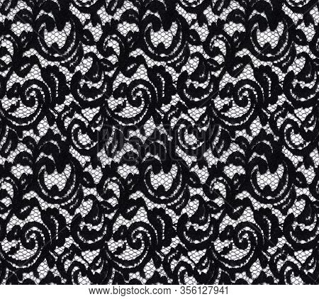 Seamless Pattern In The Form Of An Elegant Black Lace On A White Background. Lace With Floral Motifs
