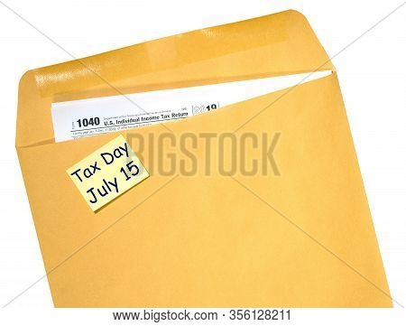 Printed Form 1040 For Income Tax Return In Brown Envelope With Reminder For July 15 Tax Day Due To C