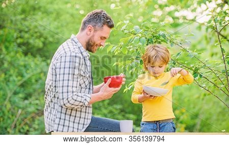 Family Enjoy Homemade Meal. Healthy Breakfast. Father Son Eat Food. Little Boy And Dad Eat. Nutritio