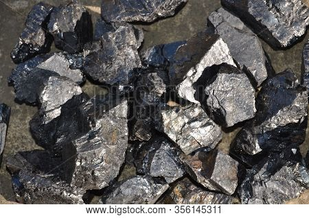 High-quality Coal Enriched With A Large Fraction Of Anthracite Glistens In The Sun.