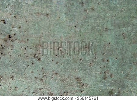 Background Of Green Oxidized Bronze With Potholes And Interspersed .. Texture Of Oxides On Brass