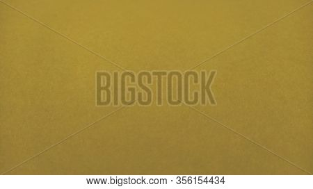 Nice Yellow Background. A Sheet Of Paper Close-up. Pure Cheerful Color. Muted Shade Of Yellow, Close
