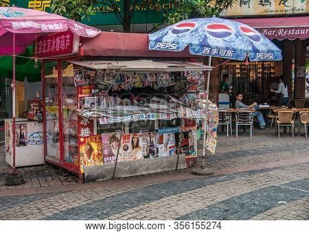 Guilin, China - May 10, 2010: Downtown. Newsstand Selling Colorful Mix Of Newspapers, Magazines And