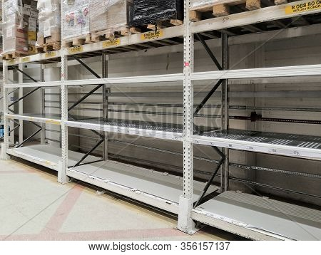 Khimki, Russia - March, 2020: Empty Shelves Of Auchan Store In The Grocery Department