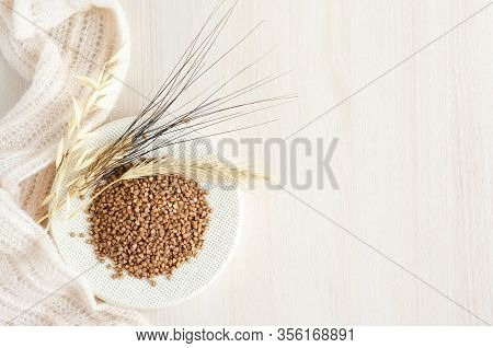 Scarce, Expensive Buckwheat Porridge On White Wooden Background, Copy Space. Food In Crisis And Hung