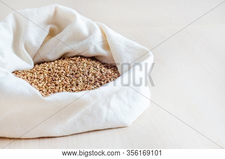 Groats, Raw Buckwheat Porridge In Bag On White Wooden Background, Copy Space. Emergency Ration