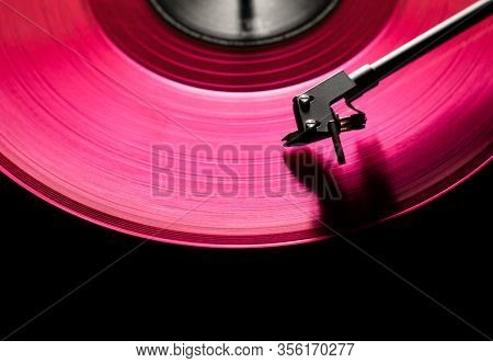 Pink Vinyl Disc. Close-up. Techno Music. Black Background,