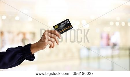 Business Shopping Ideas Concept For Web Banner. Close Up Of Woman Hand Holding Credit Card For Shopp