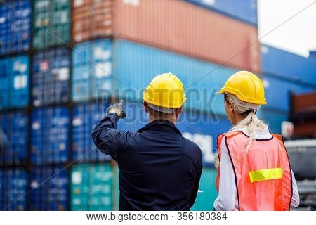Warehouse Shipping Transportation Concept. Commercial Docks Worker And Inspector At Commercial Dock.