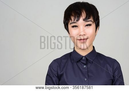 Face Of Happy Young Androgynous Asian Transgender Woman