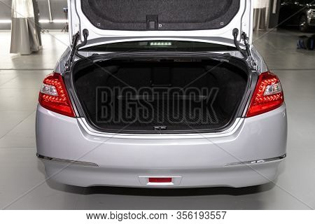 Novosibirsk, Russia - March 07, 2020: Nissan Teana,  Rear View Of A Car With An Open Trunk. Exterior