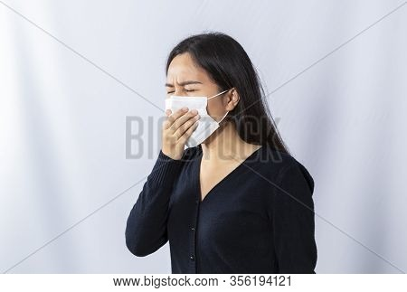 Asian Woman Wearing Medical Face Mask, With Hand Cover His Mouth While Coughing, Prevent The Spread
