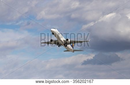 CLUJ-NAPOCA, ROMANIA - 12 MARCH 2020: A Lufthansa jet takes off from Cluj-Napoca airport on the day when trump announces suspension of transantlantic flights between the US and EU