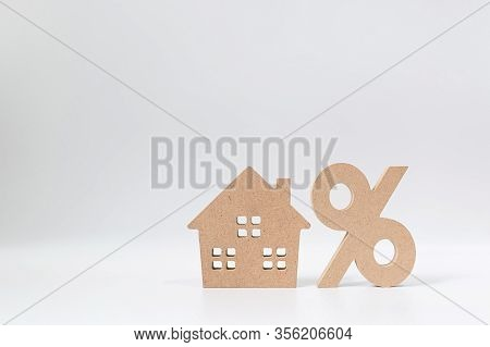 Interest Rate Property Investment Mortgage Concept. Percentage  And House Sign Symbol Icon Wooden On