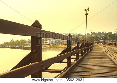 Mon Bridge Or Uttamanusorn Bridge In Sangkhla Buri, Kanchanaburi, Thailand. The Second Longest Wood