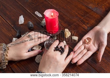 A Gypsy Woman Performs A Love Spell. A Clairvoyant Palmist Reads By Hand With A Candle. A Fortune Te