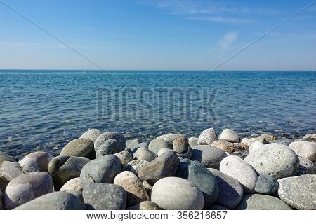 Sea View. Pebble Beach With Large Stones