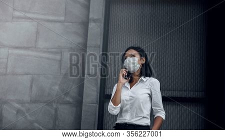 Covid-19 Or Corona Virus Situation In Business Concept. Business Woman With Medical Mask Looking Up