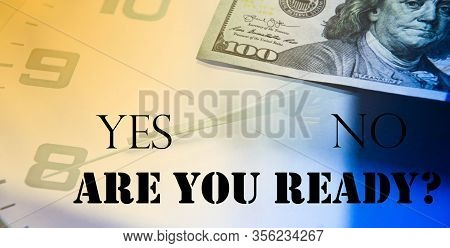 Analog Clock And Dollars On A Wooden Table. The Inscription You Are Ready? Dollars In The Form Of A