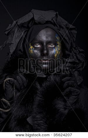 art photo of a beautiful woman with black face over black background