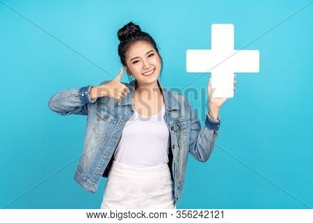 Happiness Asian Woman Smiling, Showing Plus Or Add Sign And Thumb Up Or Like On Blue Background. Cut