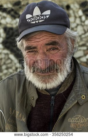 Ishkoshim, Tajikistan - June 20, 2019: Portait Of An Old Man With Mustache In The Wakhan Valley At T