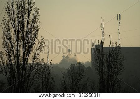 Orthodoxy Church During Sunset An Foggy Weather