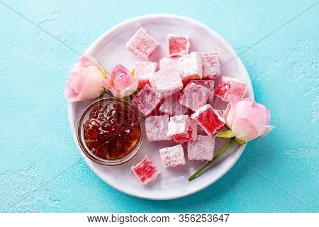 Turkish Delight Lokum, Rose Flavour In A White Plate. Blue Background. Top View.
