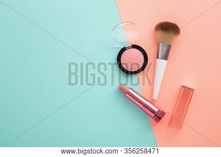 Lipstick, Blush And Brush On Pastel Color Background