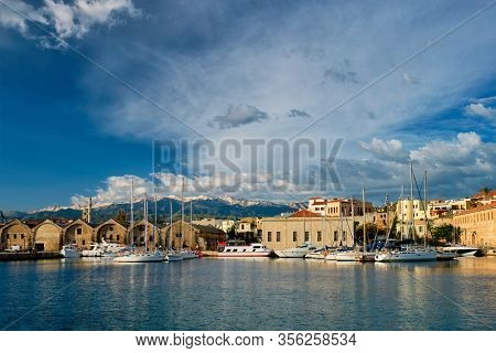 Yachts boats in picturesque old port of Chania is one of landmarks and tourist destinations of Crete island in the morning. Chania, Crete, Greece