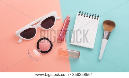 Cosmetic Beauty Products And Sunglasses With Notepad And Sunglasses