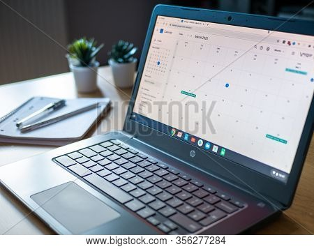 March 2020 Uk: Organised Calendar Laptop Chromebook Working At Home With Notepad