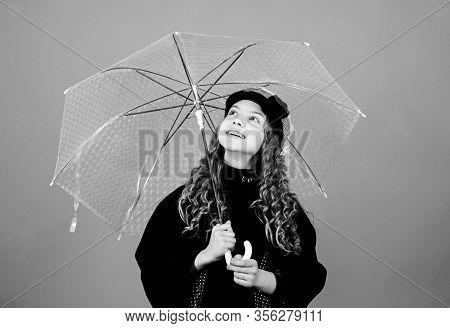 Kids Fashion Trend. Love Rainy Days. Kid Girl Happy Hold Transparent Umbrella. Enjoy Rainy Weather W