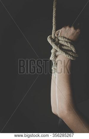 Hands Of A Missing Kidnapped,  Victim Woman Tied Up With Rope,slavery, Human Trafficking.