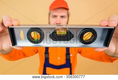 Handsome Architect Or Construction Worker With Construction Level. Professional Building Level. Shoc