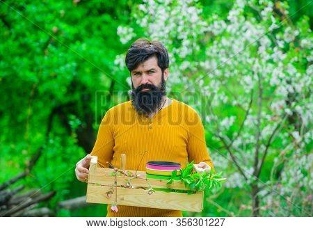 Farmer Hold Box. Spring Farming. Farmer Works In Garden. Man Farmer. Bearded Man Preparing To Planti