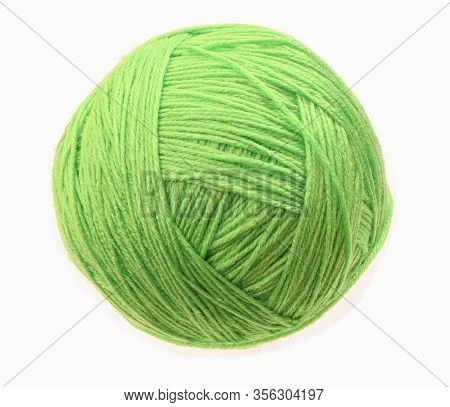 Clew Of Woolen Thread Isolated On A White Background. Green Ball Of Woolen.