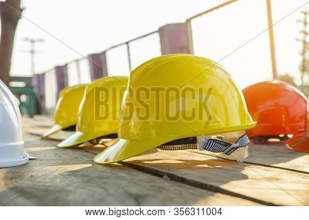 Safety Helmet (hard Hat) For Safety And Health Officer,engineer Or Architect Place On Old Wooden Flo